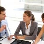 Business presentation around table — Stock Photo