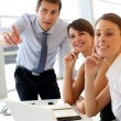 Business looking at business plan on board — Stock Photo