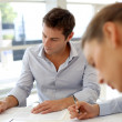 Business partners signing contractual documents — Stock Photo