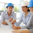 Foto Stock: Architects working in office on construction project