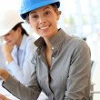 Stock Photo: Architect with security helmet using electronic tablet