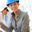 Architect with security helmet using electronic tablet — Stock Photo