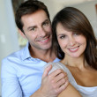 Foto Stock: Portrait of married couple at home