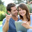 Stock Photo: Couple websurfing on internet with tablet