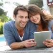 Couple websurfing on internet with tablet — Stock Photo #13961158