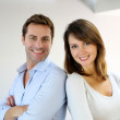 Portrait of married couple standing with arms crossed — Stock Photo #13961195