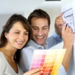 Couple choosing paint colour for their new home — Stock Photo #13961315