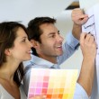 Couple choosing paint colour for their new home — Stock Photo #13961322