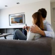 Back view of couple at home watching tv — Stock Photo