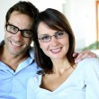 Smiling couple wearing eyeglasses - Stock Photo