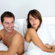 Couple sitting back to back in bed, arguing — Stock Photo #13961413