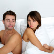 Couple sitting back to back in bed, arguing — Stock Photo #13961422