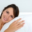 Portrait of beautiful woman laying in bed — Stock Photo