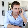Home office worker talking on mobile phone — Stock Photo #13961591