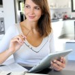 Beautiful teleworker working from home — Stock Photo #13961615