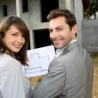 Couple on construction site checking building progress — Stock Photo
