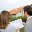 Couple looking at their new built house — Stock Photo #13961824