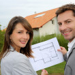 Couple looking at their new built house — Stock Photo #13961832