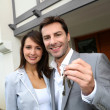 Couple in front of new home holding door keys — Stock Photo #13961849