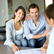 Couple meeting architect for plans of future home — Stock Photo #13961908