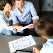 Couple meeting architect for plans of future home — Stock Photo #13961911