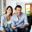 Stock Photo: Couple meeting architect for plans of future home