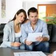 Couple meeting architect for plans of future home — Stock Photo #13961917