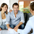 Stock Photo: Couple signing financial terms for future property