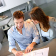 Couple meeting architect for plans of future home — Stock Photo #13961939