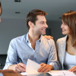 Couple meeting architect for plans of future home — Stock Photo #13961942