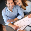 Couple meeting architect for plans of future home — Stock Photo #13961958