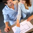 Couple concluding construction and financial contract — Stock Photo #13961960