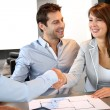 Couple concluding construction and financial contract — Foto Stock #13961965