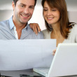 Couple looking at future home blueprint — Stock Photo #13961988