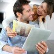 Couple choosing paint colour for their new home — Stock Photo #13962027