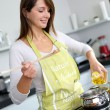 Woman in kitchen preparing pasta dish — Stock Photo #13962138