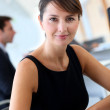Businesswoman in office writing notes — Stock Photo