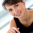 Portrait of attractive businesswoman sitting in office — Stock Photo