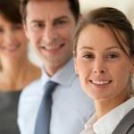 Portrait of businesswoman, team in background — Stock Photo