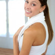 Portrait of cheerful woman exercising in gym — Stock Photo #13963051