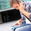 University student using digital tablet and headphones — Stock Photo #13964428