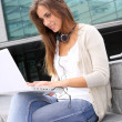 Young girl at university using laptop computer — Stock Photo #13964454