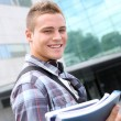 Portrait of cheerful student at college — Stockfoto