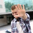 Student showing hand towards camera — Stock Photo #13964478