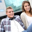 Stock Photo: Young couple sitting outside the college building