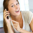 Cheerful young woman talking on the phone — Stock Photo #13964719