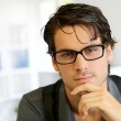 Portrait of handsome young man with glasses — Stock Photo #13964745