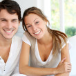 Portrait of smiling young couple at home — Stockfoto #13964800