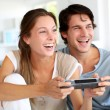 Young couple playing video games at home - Stockfoto