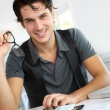 Stock Photo: Portrait of young man working in office
